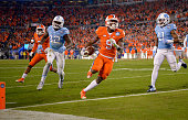 Wayne Gallman of the Clemson Tigers scores a touchdown against the North Carolina Tar Heels in the 1st quarter during the Atlantic Coast Conference...