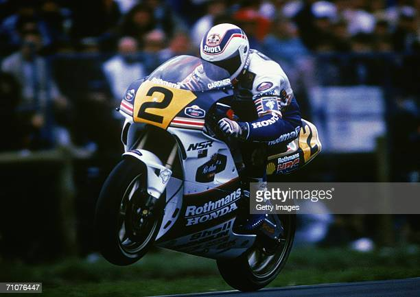 Wayne Gardner of Australia for the Rothmans Honda Team wheelies his bike during the 1989 Australian Motorcycle Grand Prix at Phillip Island in...
