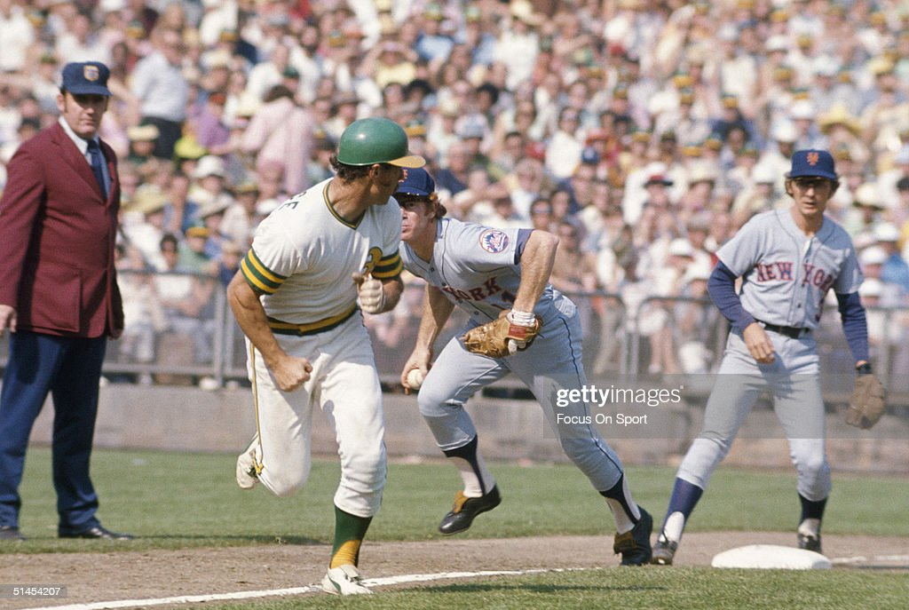 Wayne Garrett of the New York Mets tries waits for the ball while Gene Tenace of the Oakland Athletics runs for second base during the World Series...