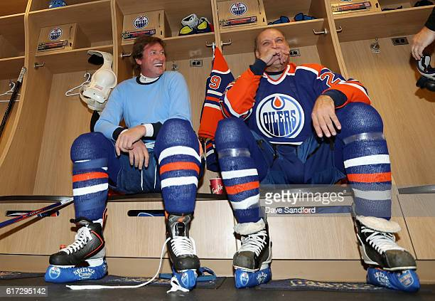 Wayne Gretzky and Dave Semenko of the Edmonton Oilers alumni share a laugh in the locker room before playing in the 2016 Tim Hortons NHL Heritage...