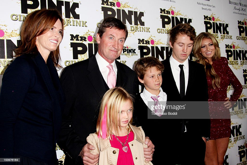 Wayne Gretzky (C) and family attend the Mr. Pink ginseng drink launch party held at the Regent Beverly Wilshire Hotel on October 11, 2012 in Beverly Hills, California.