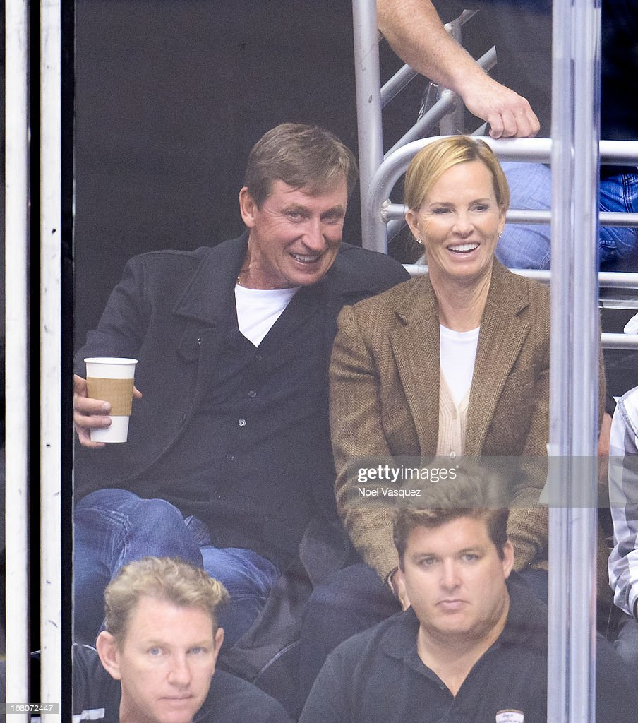 Wayne Gretzky (L) and his wife Janet Gretzky attend an NHL playoff game between the St. Louis Blues and the Los Angeles Kings at Staples Center on May 4, 2013 in Los Angeles, California.