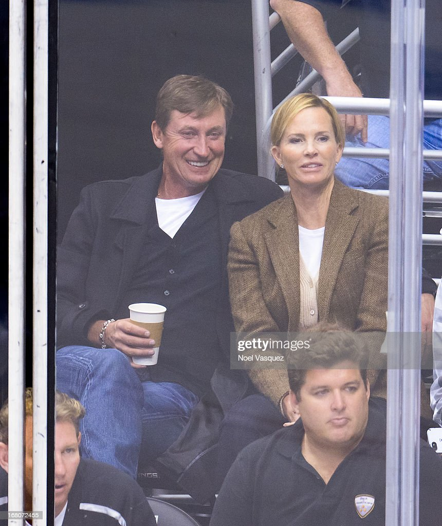 <a gi-track='captionPersonalityLinkClicked' href=/galleries/search?phrase=Wayne+Gretzky+-+Ice+Hockey+Player&family=editorial&specificpeople=157520 ng-click='$event.stopPropagation()'>Wayne Gretzky</a> (L) and his wife Janet Gretzky attend an NHL playoff game between the St. Louis Blues and the Los Angeles Kings at Staples Center on May 4, 2013 in Los Angeles, California.