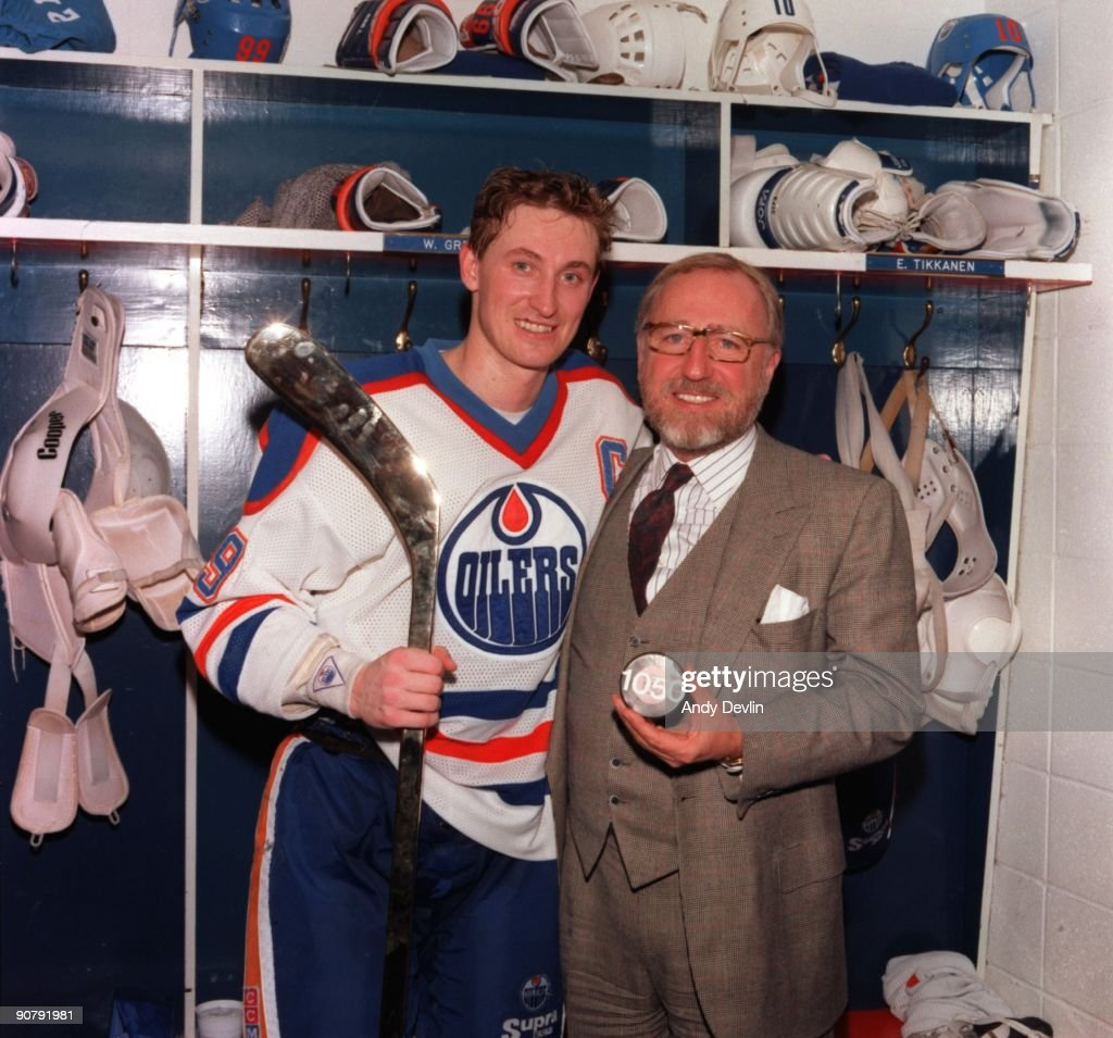 <a gi-track='captionPersonalityLinkClicked' href=/galleries/search?phrase=Wayne+Gretzky+-+Ice+Hockey+Player&family=editorial&specificpeople=157520 ng-click='$event.stopPropagation()'>Wayne Gretzky</a> #99 and owner Peter Pocklington of the Edmonton Oilers pose for a photo in the locker room with Pocklington holding a puck with 1050 marked on it to mark Gretzky's 1050th assist against the Los Angeles Kings on March 1, 1988 in Edmonton, Alberta, Canada.