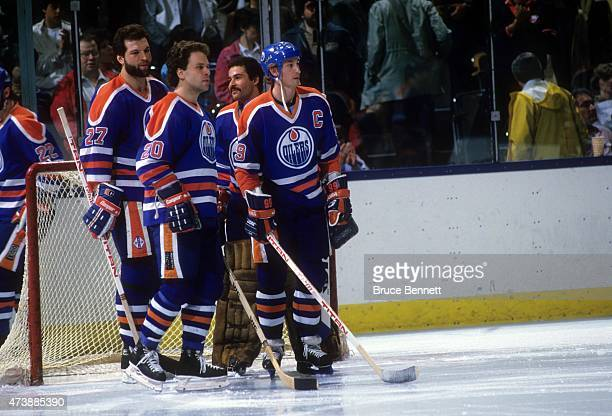 Wayne Gretzky Billy Carroll Dave Semenko and goalie Grant Fuhr of the Edmonton Oilers stand around the net before an NHL game against the New York...