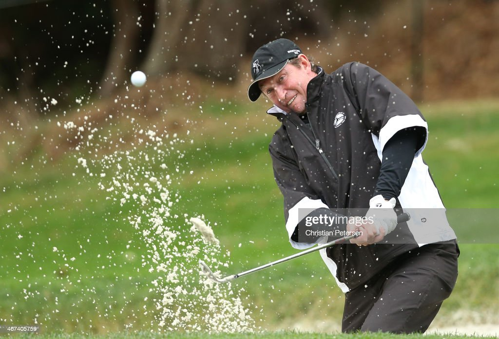 Wayne Gretzky chips from the bunker onto the 16th hole green during the first round of the AT&T Pebble Beach National Pro-Am at Spyglass Hill Golf Course on February 6, 2014 in Pebble Beach, California.