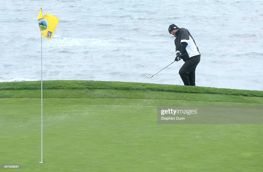 Wayne Gretzky chips onto the eighth green during the third round of the AT&T Pebble Beach National Pro-Am at the Pebble Beach Golf Links on February 8, 2014 in Pebble Beach, California.