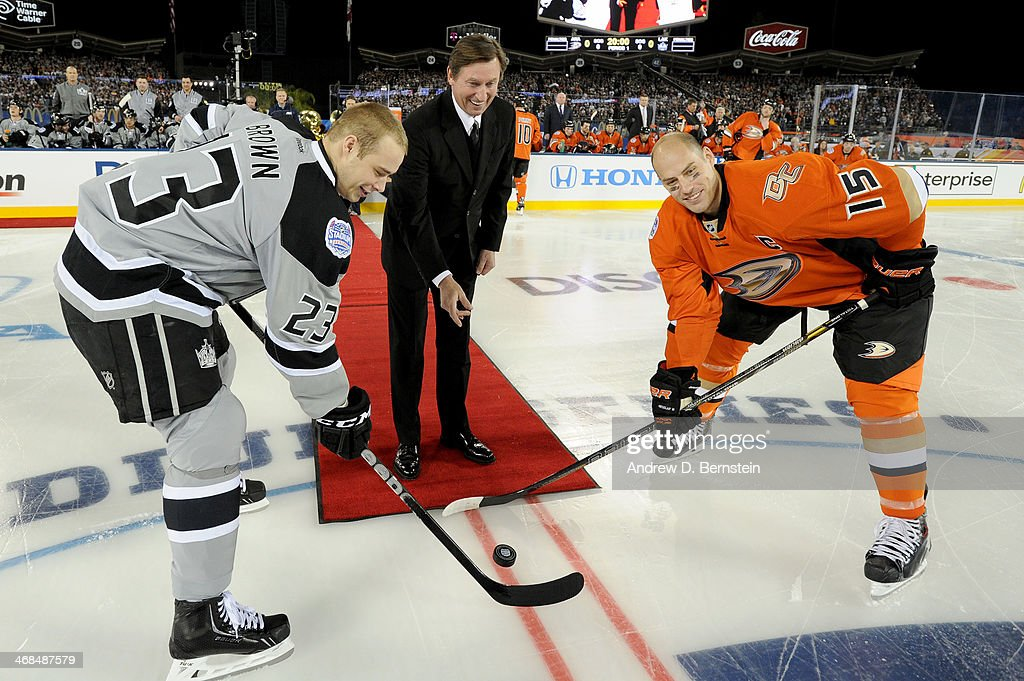 Wayne Gretzky drops the ceremonial puck with Dustin Brown #23 of the Los Angeles Kings and Ryan Getzlaf #15 of the Anaheim Ducks during the 2014 Coors Light NHL Stadium Series at Dodger Stadium on January 25, 2014 in Los Angeles, California.