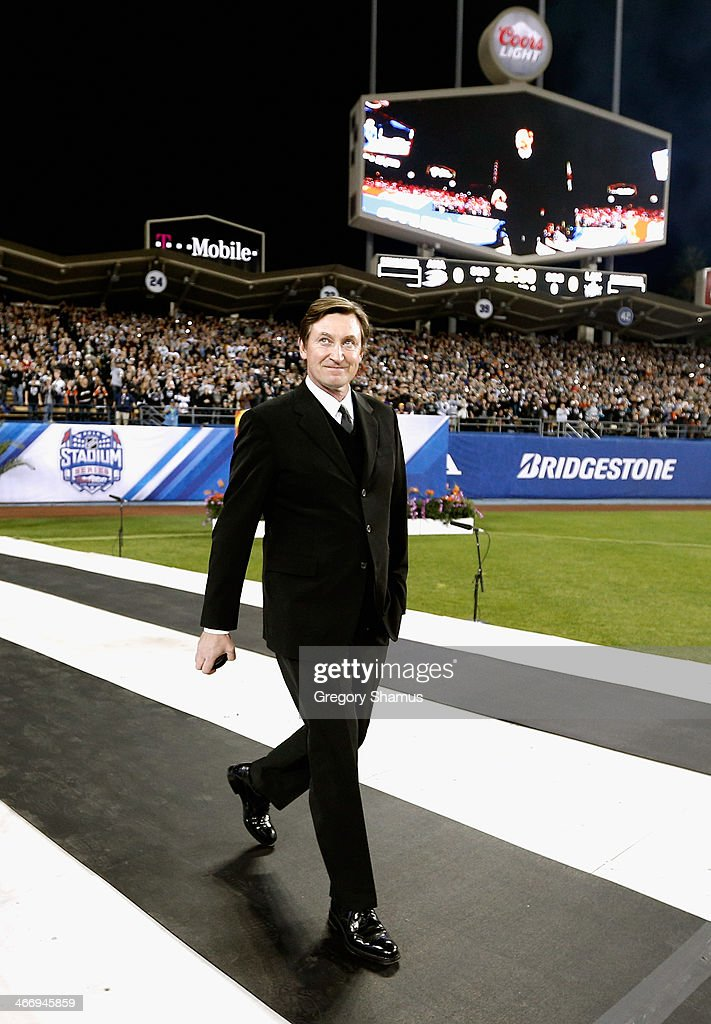 Wayne Gretzky enters Dodger Stadium on his way to drop the ceremonial first puck to start the 2014 Coors Light NHL Stadium Series game between the Los Angeles Kings and the Anaheim Ducks on January 25, 2014 in Los Angeles, California.