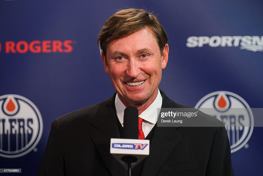 Wayne Gretzky gives a press conference between periods during an NHL game between the Edmonton Oilers and the New York Islanders at Rexall Place on March 06, 2014 in Edmonton, Alberta, Canada.