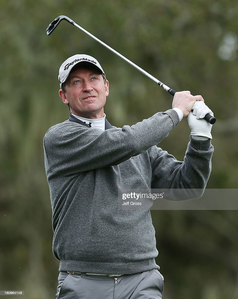 Wayne Gretzky hits a shot during the first round of the AT&T Pebble Beach National Pro-Am at the Monterey Peninsula Country Club on February 7, 2013 in Pebble Beach, California.