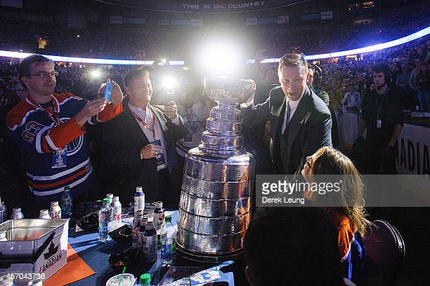 Wayne Gretzky holds the Stanley Cup during the Edmonton Oilers Stanley Cup Reunion at Rexall Place on October 10 2014 in Edmonton Alberta Canada