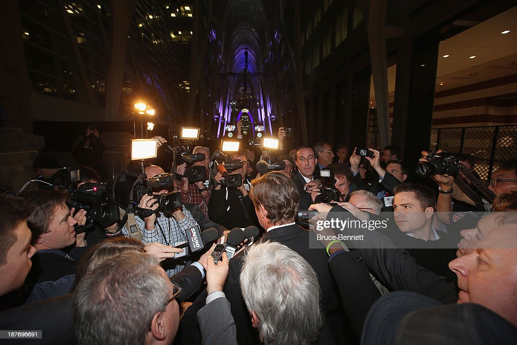 Wayne Gretzky is surrounded by media during the red carpet event prior to the 2013 Hockey Hall of Fame induction ceremony on November 11, 2013 in Toronto, Canada.