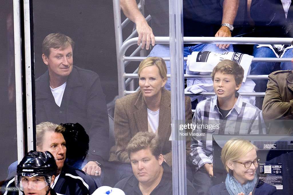 <a gi-track='captionPersonalityLinkClicked' href=/galleries/search?phrase=Wayne+Gretzky+-+Ice+Hockey+Player&family=editorial&specificpeople=157520 ng-click='$event.stopPropagation()'>Wayne Gretzky</a>, Janet Gretzky and Tristan Gretzky attend an NHL playoff game between the St. Louis Blues and the Los Angeles Kings at Staples Center on May 4, 2013 in Los Angeles, California.