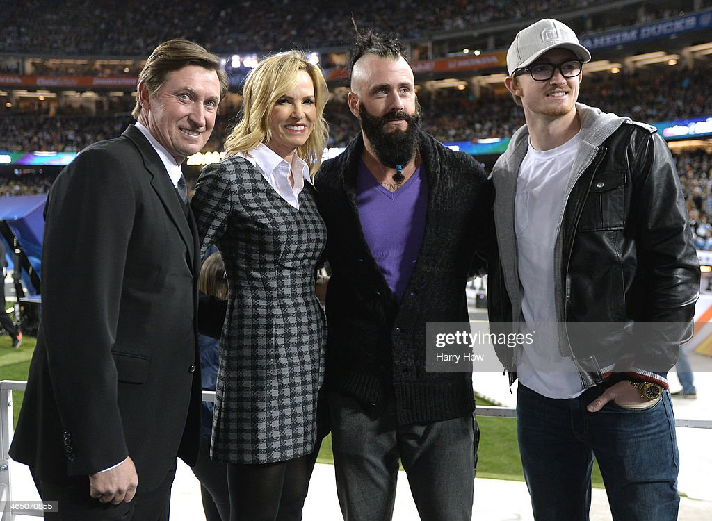 Wayne Gretzky, Janet Gretzky, Brian Wilson #00 of the Los Angeles Dodgers and Trevor Gretzky pose for a photo before the game between the Los Angeles Kings and the Anaheim Ducks during the 2014 Coors Light NHL Stadium Series at Dodger Stadium on January 25, 2014 in Los Angeles, California.
