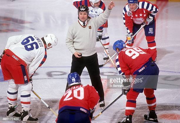 Wayne Gretzky of the Campbell Conference and the Los Angeles Kings and Mario Lemieux of the Wales Conference and the Pittsburgh Penguins wait for...