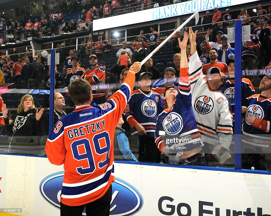 Wayne Gretzky of the Edmonton Oilers Alumni give his stick to fans following the the Farewell Rexall Place ceremony following the game against the Vancouver Canucks on April 6, 2016 at Rexall Place in Edmonton, Alberta, Canada.