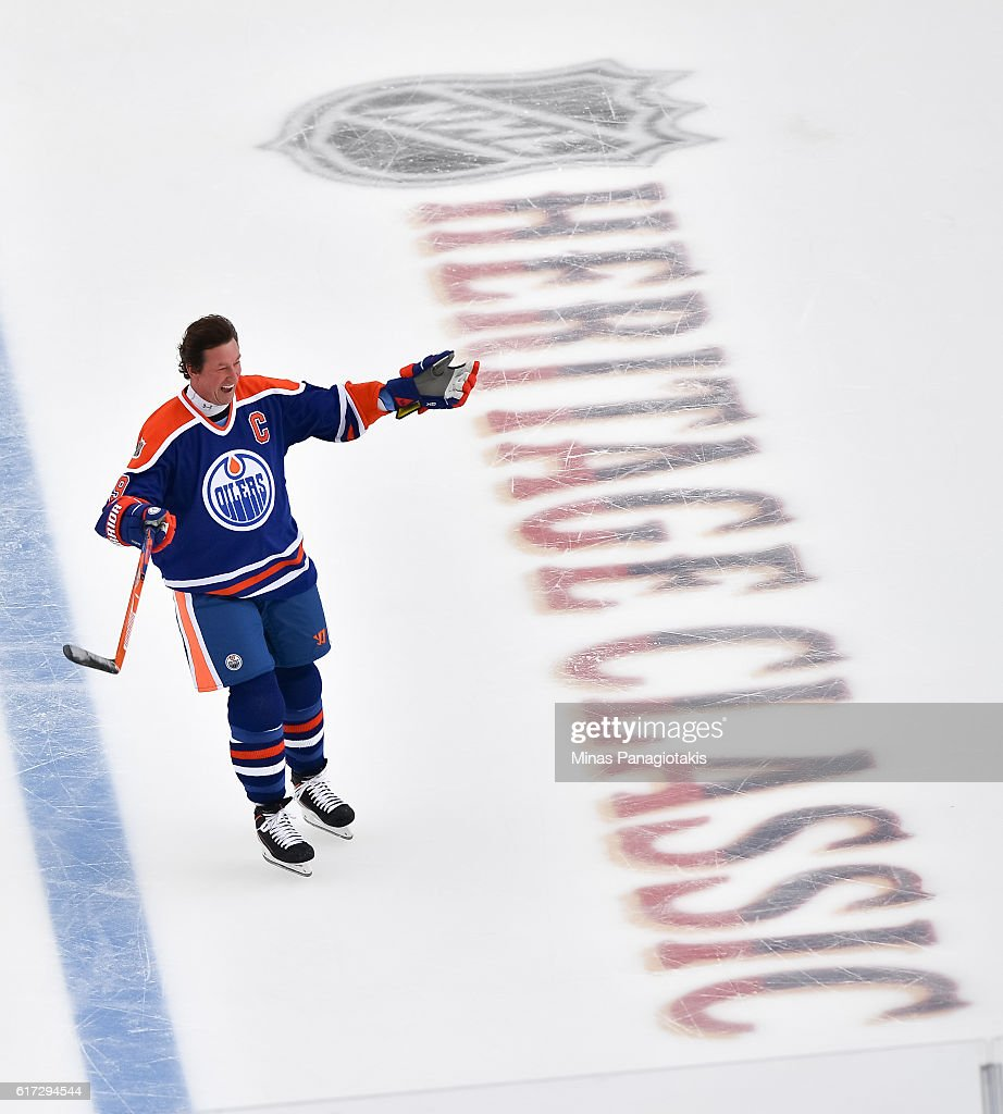 Wayne Gretzky #99 of the Edmonton Oilers alumni waves to the crowd during the 2016 Tim Hortons NHL Heritage Classic alumni game at Investors Group Field on October 22, 2016 in Winnipeg, Canada.