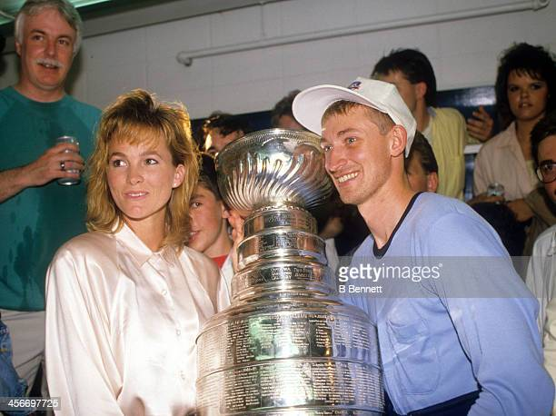 Wayne Gretzky of the Edmonton Oilers and wife Janet Jones celebrate after the Edmonton Oilers defeated the Boston Bruins in Game 5 of the 1988...