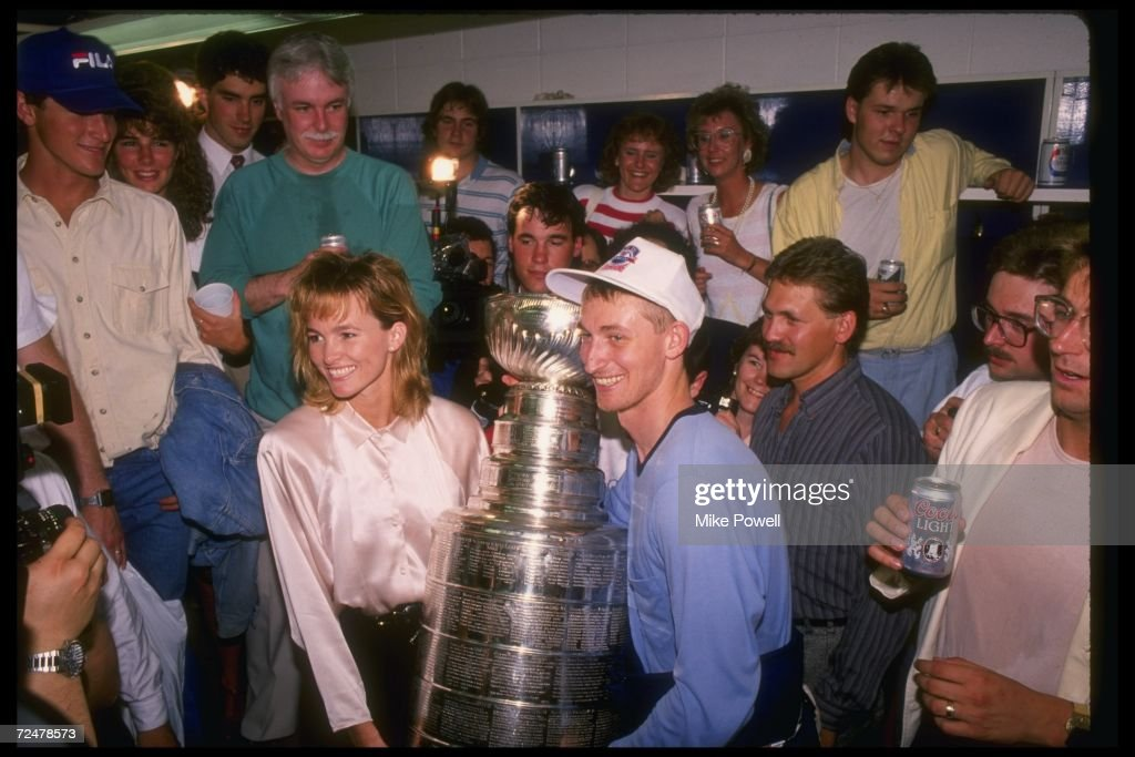 Wayne Gretzky #99 of the Edmonton Oilers and wife Janet Jones celebrate after the Edmonton Oilers defeated the Boston Bruins in Game 5 of the 1988 Stanley Cup Finals on May 26, 1988 at the Northlands Coliseum in Edmonton, Alberta, Canada.
