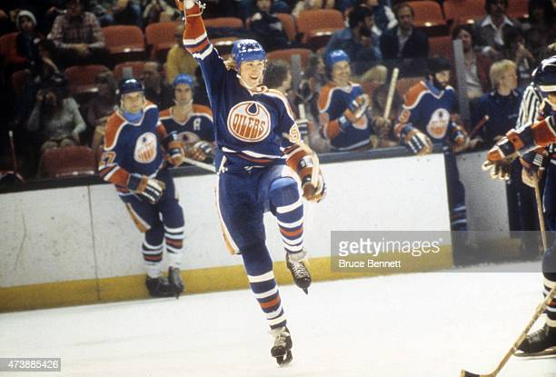 Wayne Gretzky of the Edmonton Oilers celebrates a goal during a WHA game against the New England Whalers in April 1979 at the Hartford Civic Center...