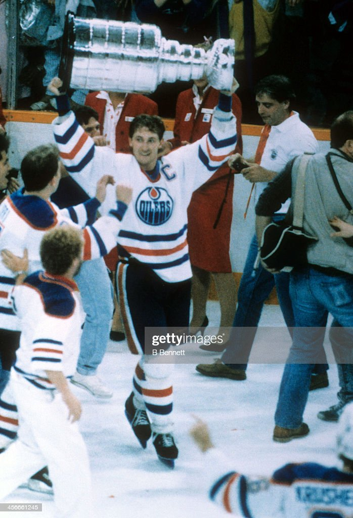 <a gi-track='captionPersonalityLinkClicked' href=/galleries/search?phrase=Wayne+Gretzky+-+Ice+Hockey+Player&family=editorial&specificpeople=157520 ng-click='$event.stopPropagation()'>Wayne Gretzky</a> #99 of the Edmonton Oilers celebrates with the Stanley Cup after the Oilers defeated the Philadelphia Flyers in Game 7 of the 1987 Stanley Cup Finals on May 31, 1987 at the Northlands Coliseum in Edmonton, Alberta, Canada.