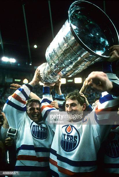 Wayne Gretzky of the Edmonton Oilers celebrates with the Stanley Cup after the Oilers defeated the Philadelphia Flyers in Game 7 of the 1987 Stanley...