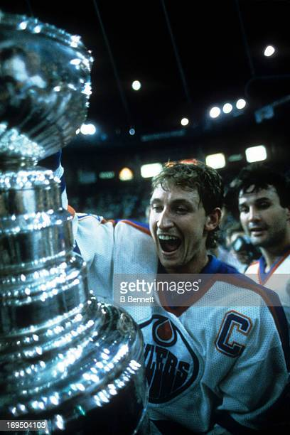 Wayne Gretzky of the Edmonton Oilers holds the Stanley Cup after Game 7 of the 1987 Stanley Cup Finals against the Philadelphia Flyers on May 31 1987...