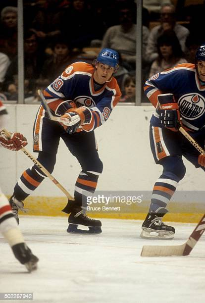 Wayne Gretzky of the Edmonton Oilers passes the puck during an NHL game against the New Jersey Devils on March 1 1983 at the Brendan Byrne Arena in...