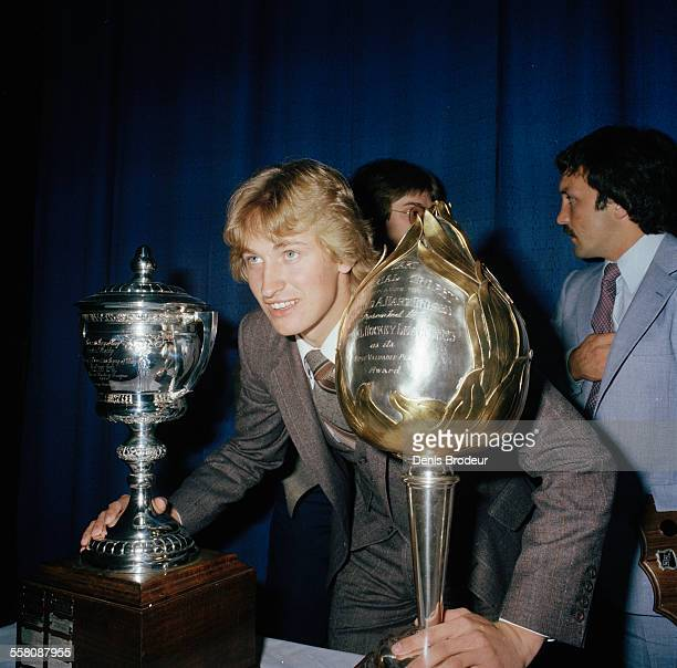 Wayne Gretzky of the Edmonton Oilers poses for a photo after winning the Hart Memorial Trophy and the Lady Byng Memorial Trophy circa 1980 at the...