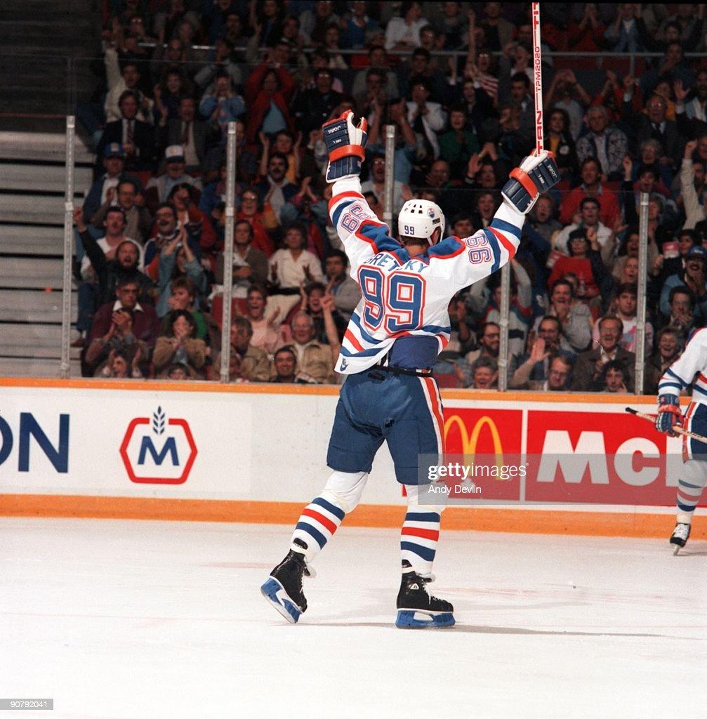 Wayne Gretzky of the Edmonton Oilers raises his arms in jubilation during an NHL game circa 198687 in Edmonton Alberta Canada