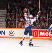 Wayne Gretzky of the Edmonton Oilers raises his arms in jubilation during an NHL game circa 198687 in Edmonton Alberta Canada