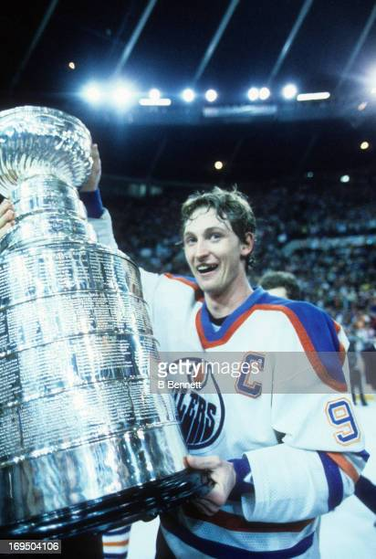 Wayne Gretzky of the Edmonton Oilers recieves the Stanley Cup Trophy after the Oilers defeated the Philadelphia Flyers in Game 5 of the 1985 Stanley...
