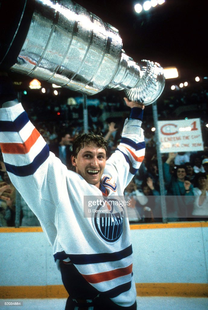 <a gi-track='captionPersonalityLinkClicked' href=/galleries/search?phrase=Wayne+Gretzky+-+Ice+Hockey+Player&family=editorial&specificpeople=157520 ng-click='$event.stopPropagation()'>Wayne Gretzky</a> #99 of the Edmonton Oilers recieves the Stanley Cup Trophy after the Oilers defeated the Philadelphia Flyers in Game 7 of the 1987 Stanley Cup Finals on May 31, 1987 at the Northlands Coliseum in Edmonton, Alberta, Canada.