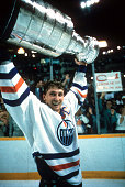 Wayne Gretzky of the Edmonton Oilers recieves the Stanley Cup Trophy after the Oilers defeated the Philadelphia Flyers in Game 7 of the 1987 Stanley...