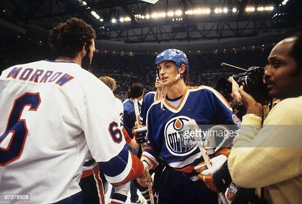 Wayne Gretzky of the Edmonton Oilers shakes hands with Ken Morrow of the New York Islanders after the Islanders defeated the Edmonton Oilers 42 in...