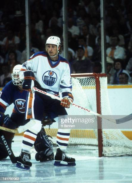 Wayne Gretzky of the Edmonton Oilers skates in front of goalie Billy Smith of the New York Islander during the 1983 Stanley Cup Finals in May 1983 at...