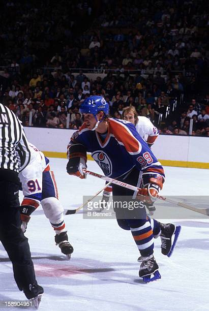 Wayne Gretzky of the Edmonton Oilers skates on the ice during an NHL game against the New York Islanders on December 13 1983 at the Nassau Coliseum...