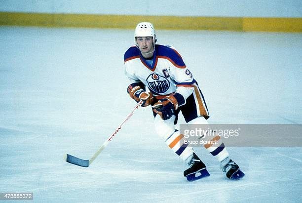 Wayne Gretzky of the Edmonton Oilers skates on the ice during the 1984 Stanley Cup Finals against the New York Islanders in May 1984 at the...