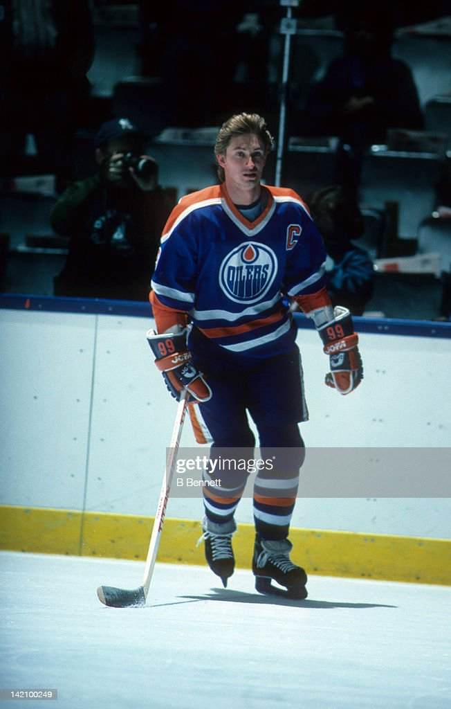 Wayne Gretzky of the Edmonton Oilers skates on the ice during warm ups before the game against the New York Islanders during the 1984 Stanley Cup...