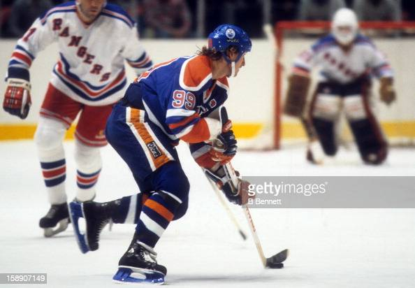 Wayne Gretzky of the Edmonton Oilers skates with the puck during an NHL game against the New York Rangers on October 30 1983 at the Madison Square...
