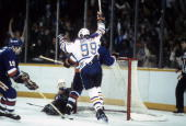 Wayne Gretzky of the Edmonton Oilers throws his hands in the air after the Oiler score against the New York Islanders in the 1984 NHL Stanley Cup...
