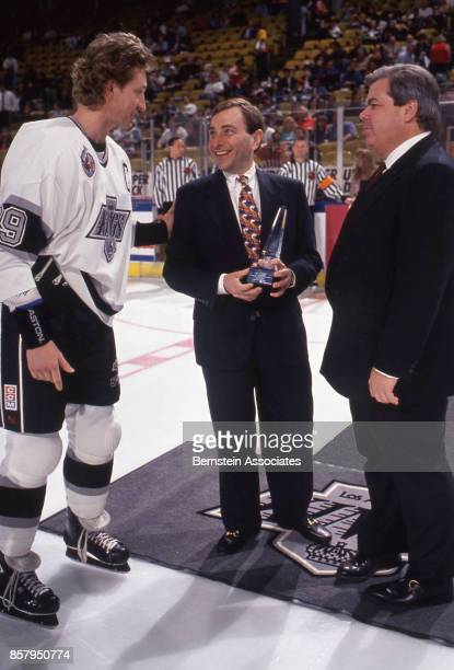 Wayne Gretzky of the Los Angeles Kings accepts award from Gary Bettman for 1000th game played on May 11 1993 at the Great Western Forum in Inglewood...