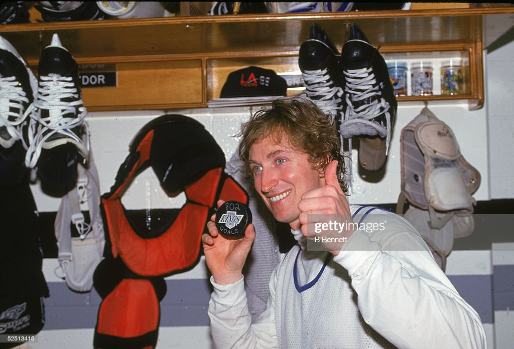 <a gi-track='captionPersonalityLinkClicked' href=/galleries/search?phrase=Wayne+Gretzky+-+Ice+Hockey+Player&family=editorial&specificpeople=157520 ng-click='$event.stopPropagation()'>Wayne Gretzky</a> #99 of the Los Angeles Kings poses for a portrait in the locker room while holding up the puck he scored his 802 NHL goal to pass Gordie Howe after scoring it against the Vancouver Canucks on March 24, 1994 at the Great Western Forum in Inglewood, California.
