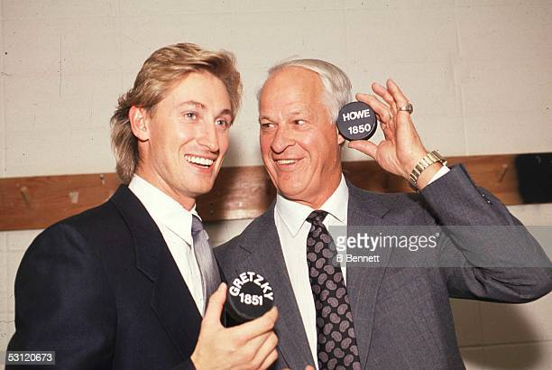Wayne Gretzky of the Los Angeles Kings stands with Gordie Howe as they pose with the 1851 puck that Gretkzy scored with to pass Howe as the alltime...