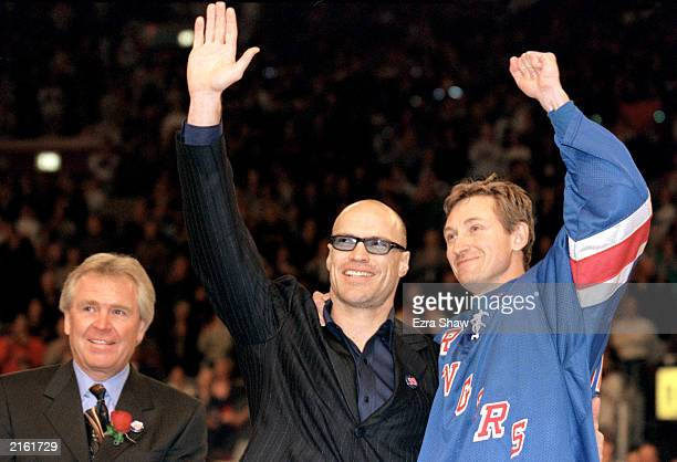 Wayne Gretzky of the New York Rangers and Mark Messier wave to the crowd after Gretzky's final career game against the Pittsburgh Penguins at the...