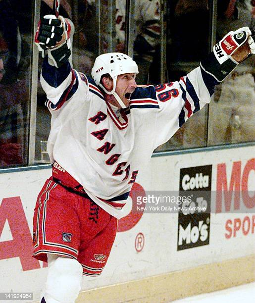 Wayne Gretzky of the New York Rangers celebrates his 1072nd goal which broke Gordie Howe's alltime goal scoring record in the NHL against the New...