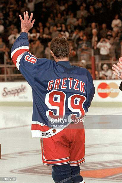 Wayne Gretzky of the New York Rangers waves to the crowd during introductions before his final career game against the Pittsburgh Penguins at the...