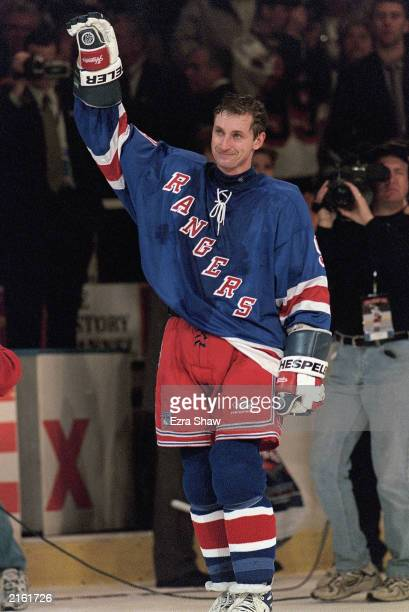 Wayne Gretzky of the New York Rangers waves to the crowd from the ice after playing in his final career game against the Pittsburgh Penguins at the...