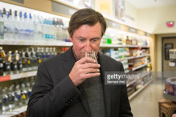 TORONTO ON OCTOBER 17 Wayne Gretzky sniffs a shot of his new No 99 Canadian Whisky he launched at the Maple Leaf Square LCBO